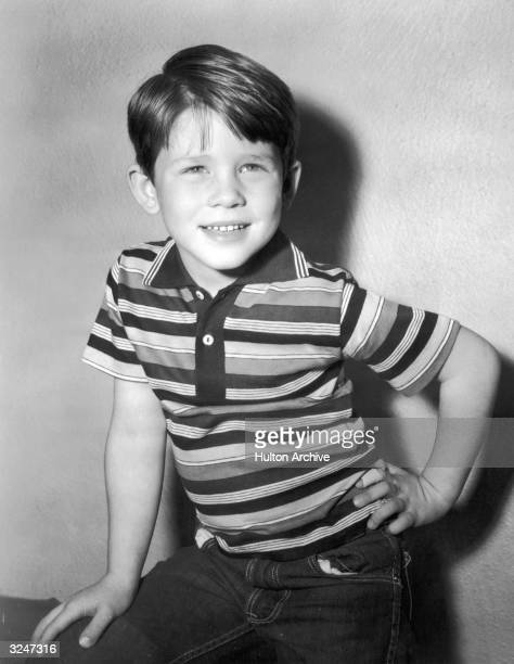 American child actor and future director Ron Howard smiles in a striped polo-T and jeans.