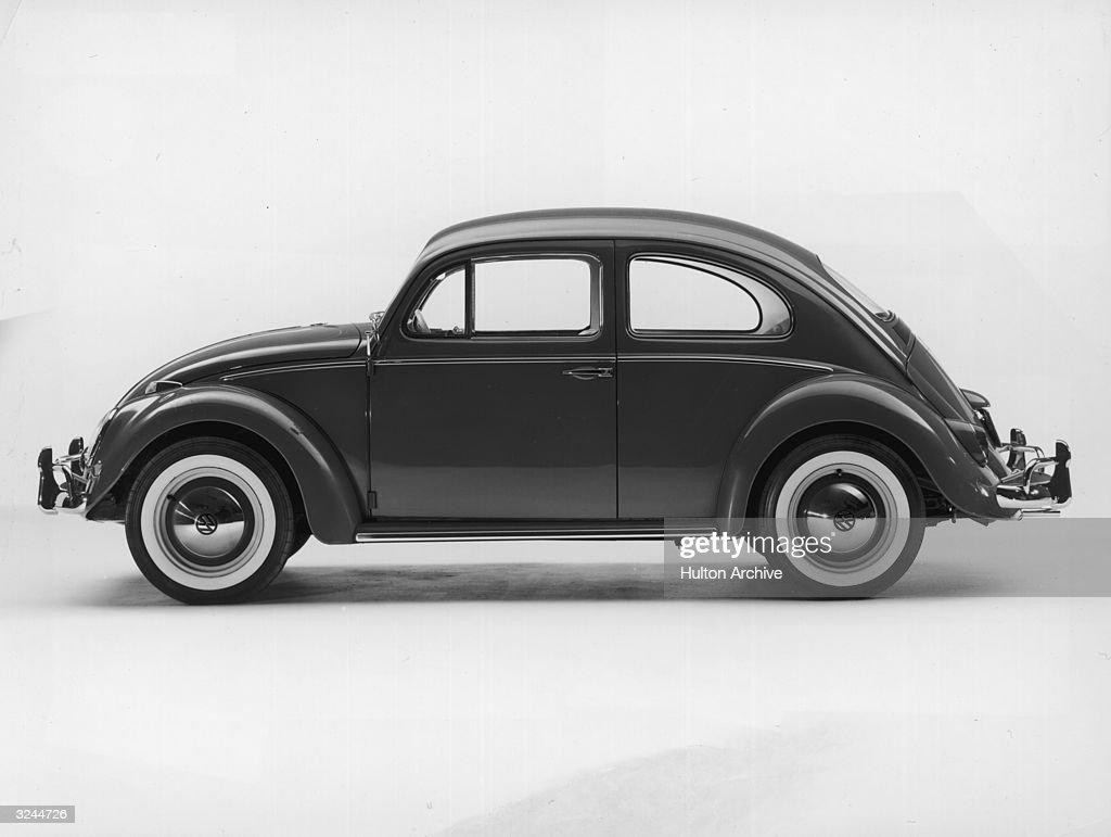 Promotional studio image of a 1962 Volkswagen Beetle Sedan.
