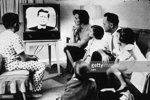 Family watching President John Kennedy on television.