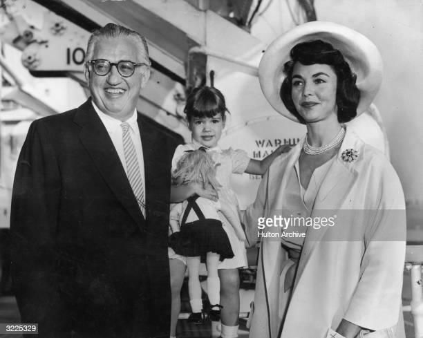 American film producer David O Selznick and his second wife actor Jennifer Jones stand on either side of their threeyearold daughter Mary Jennifer...