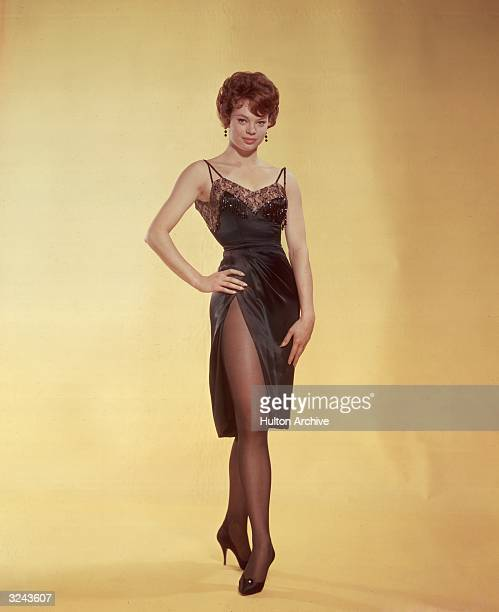 Fulllength studio portrait of Indianborn actor Juliet Prowse wearing a short black satin dress with spaghetti straps early 1960s