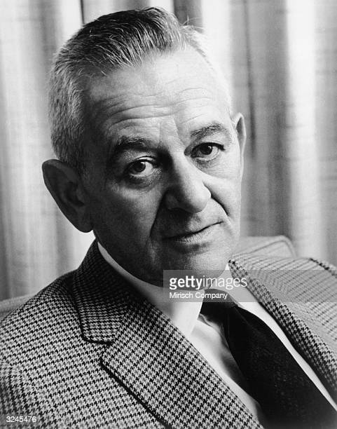 Headshot portrait of Frenchborn director William Wyler wearing a houndstooth jacket