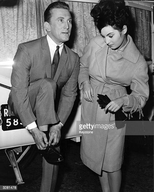US actor Kirk Douglas and Italian actress Rosanna Schiaffino during filming of the US film 'Two Weeks In Another Town' in Rome