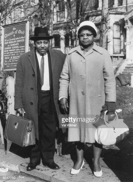 Pastor and Mrs Wallen stand outside the Church of God on Effra Road Brixton south London