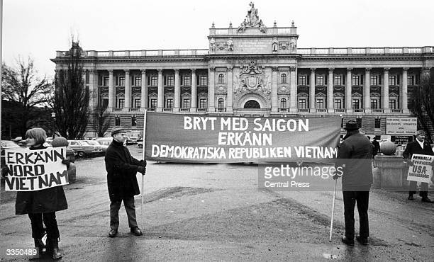 Protestors outside Sweden's Riksdag building holding a banner demanding recognition of the Democratic Republic of Vietnam during a debate on foreign...