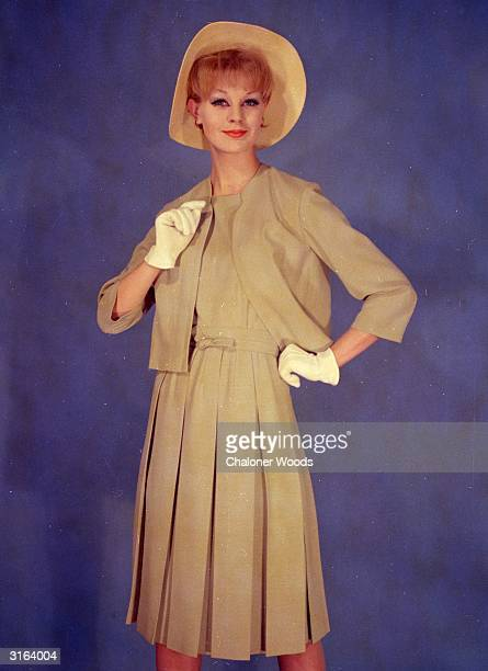 Stone coloured dress and collarless box jacket The dress has a box pleated skirt