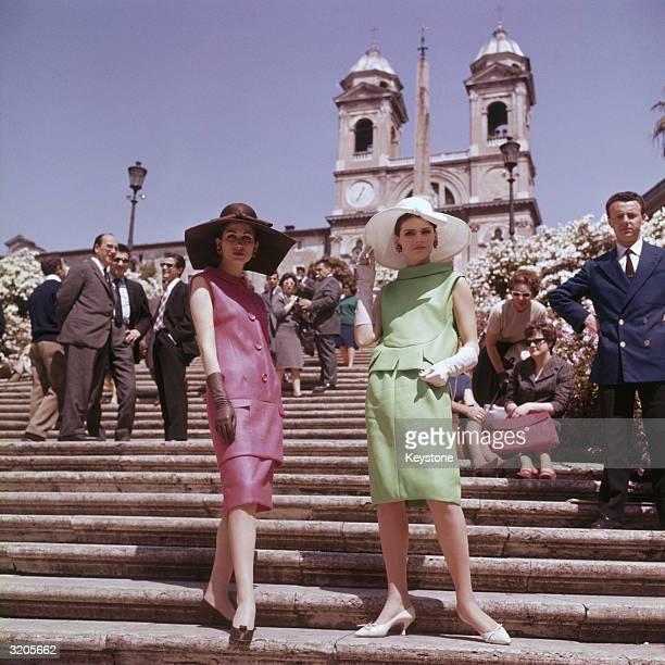 Two women modelling Italian fashions in the Piazza di Spagna in Rome