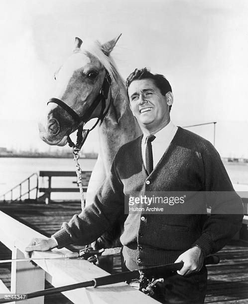 Britishborn actor Alan Young and Mr Ed the talking horse pose together in a promotional portrait for the television comedy series 'Mr Ed'