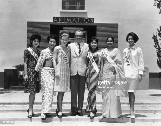 EXCLUSIVE American animator and producer Walt Disney poses outside the Animation Building at Disney studios with the Miss Universe Girls Hollywood...