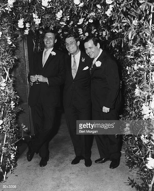 American author George Plimpton, American bandleader Peter Duchin and Robert Silvers laugh while standing under an arbor at the Zauderer-Duchin...