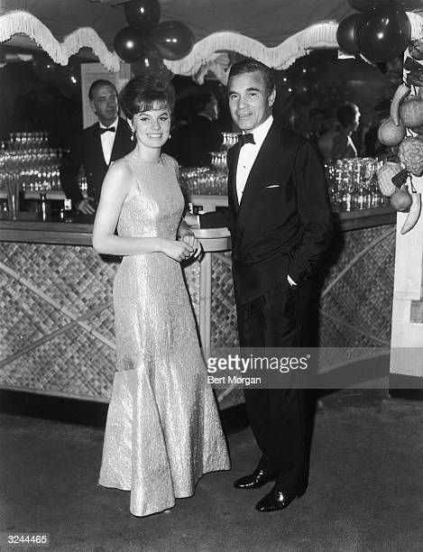 EXCLUSIVE Dominican diplomat Porfirio Rubirosa poses with his wife Odile Rodin at the bar at Cocoanuts
