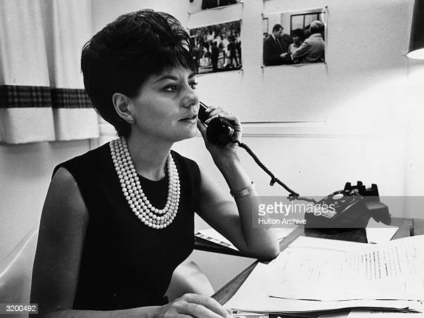 Television journalist for NBC Barbara Walters takes a phone call at her desk, New York City.