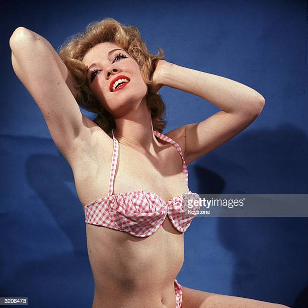 Sun worshipper wearing a skimpy bikini.