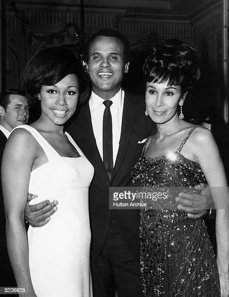 American actor and singer Harry Belafonte poses with his wife dancer Julie Robinson and American singer Diahann Carroll backstage in the Persian Room...