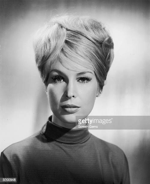 American actor Barbara Eden has a bouffant hairdo and wears a mock turtleneck sweater in a promotional studio portrait for TV's 'I Dream of Jeannie'