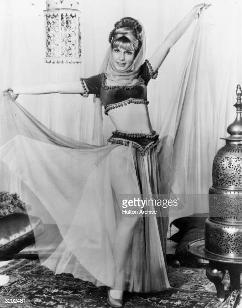 American actor Barbara Eden wears a harem costume in a fulllength promotional portrait for the television series 'I Dream of Jeannie'