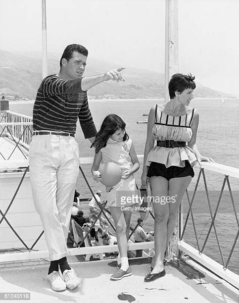 Circa 1965, American actor James Garner points while standing on a balcony with his wife, Lois, and their daughter, Kim, 1960s.