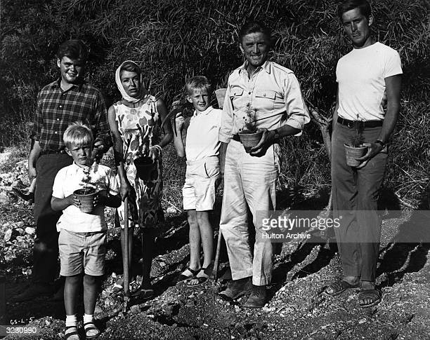 American actor Kirk Douglas poses with wife Anne and his four sons while gardening outdoors Left to right Joel Peter Eric and Michael Douglas They...
