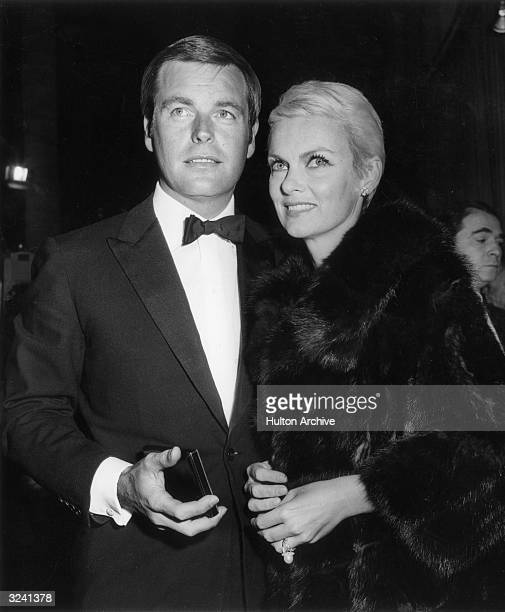 American actor Robert Wagner and his second wife actor Marion Marshall standing close together at an unidentified event Wagner wears a tuxedo...