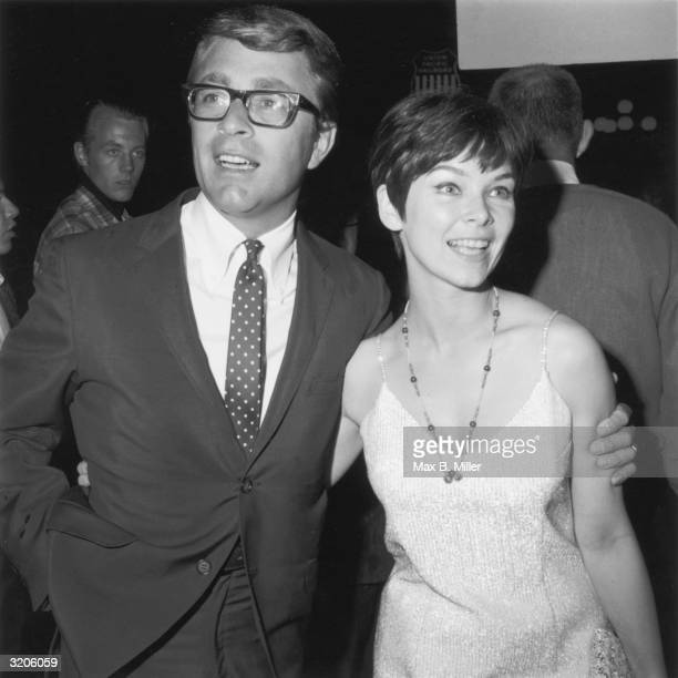 American actors Bill Bixby and Yvonne Craig stand with their arms around each other at a midnight movie premiere Los Angeles California