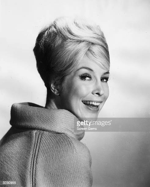 American actress Barbara Eden smiling over her shoulder wearing a cowlneck sweater Eden starred in the television series 'I Dream of Jeannie'