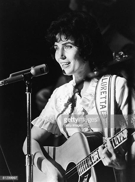 Circa 1965 American country singer and songwriter Loretta Lynn performs on stage at the Grand Ole Opry Nashville Tennessee 1960s