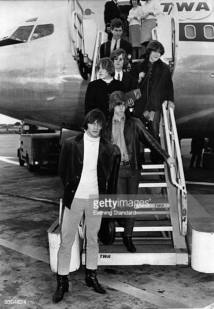 American folkrock pop group The Byrds disembarking from a TWA aeroplane