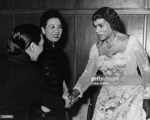 American singer Marian Anderson is congratulated by Mrs. Chen Cheng , wife of the Vice President of the Republic of China, and Madame Chiang Kai-shek...