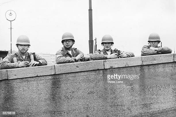 American soldiers stationed in West Berlin keeping watch over the Berlin Wall.