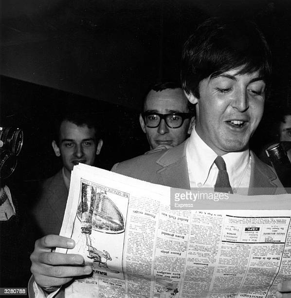 Beatle Paul McCartney gives an impromptu interview whilst reading a newspaper
