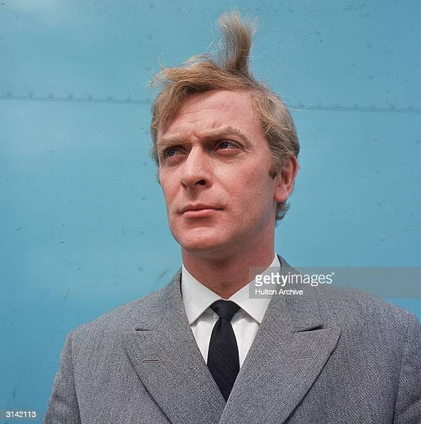 British actor Michael Caine, the star of 'Alfie' and 'Get Carter', looking windswept.