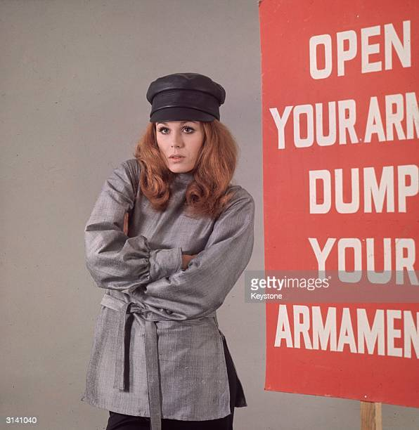British model and actress Joanna Lumley star of the TV series 'The New Avengers' dressed in a Russianstyle tunic and cap and standing next to a...
