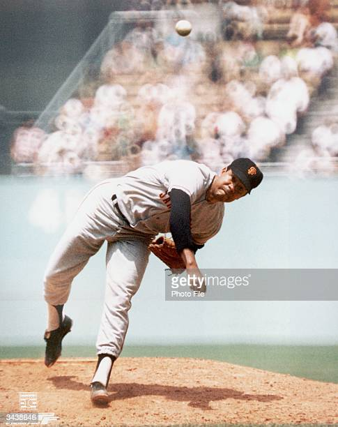 Dominian Republic born baseball player Juan Marichal, pitcher for the San Francisco Giants, releases a pitch while on the mound during a game.