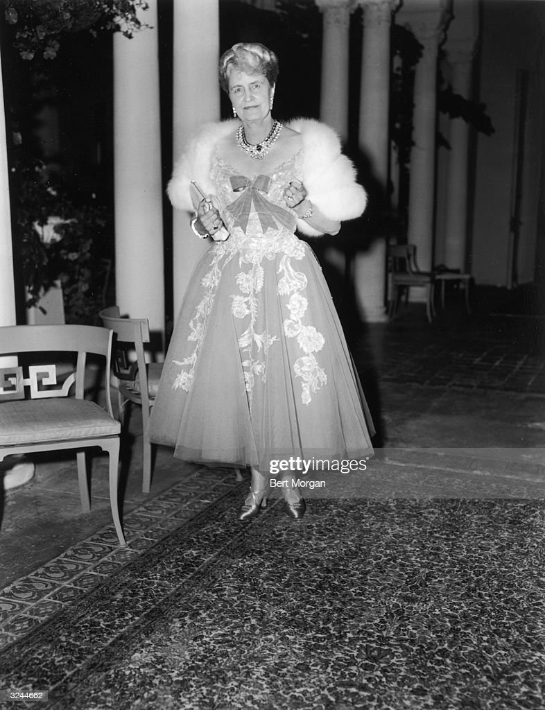 American business executive and philanthropist Marjorie Merriweather Post (1887-1973) posing in an evening gown and fur wrap, Palm Beach, Florida.