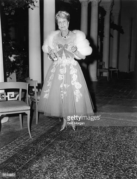 EXCLUSIVE American business executive and philanthropist Marjorie Merriweather Post posing in an evening gown and fur wrap Palm Beach Florida