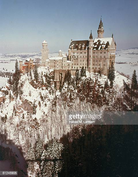 Circa 1965 Exterior view of Neuschwanstein Castle perched atop a snowcovered mountain in Bavaria Germany 1960s