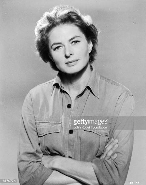 Film star Ingrid Bergman in a simple denim shirt with rolled up sleeves.