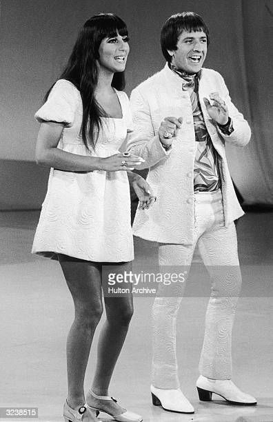 Fulllength image of married American singers Cher and Sonny Bono of the pop duo Sonny and Cher performing on 'The Carol Burnett Show' Sonny and Cher...