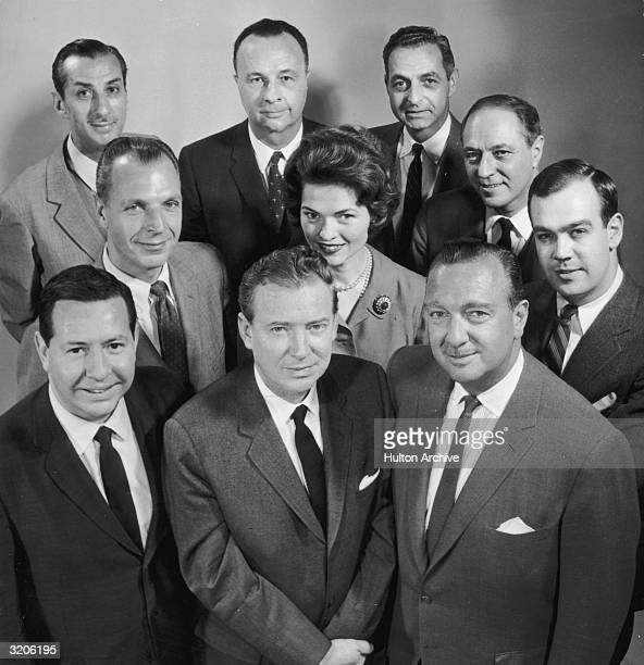 Group portrait of the CBS News team including Nancy Hanschman the first female CBS News correspondent President John F Day and colleagues Walter...