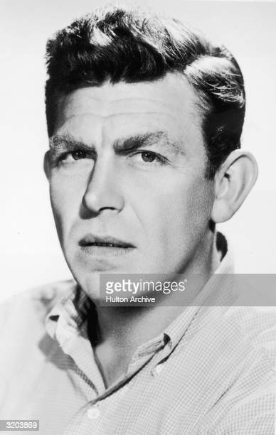 Headshot portrait of American actor Andy Griffith with a concerned expression