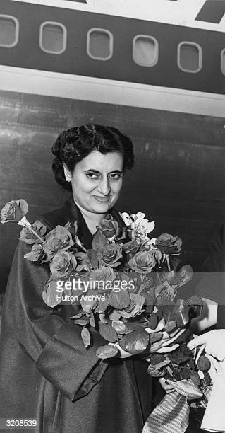 Indian Prime Minister Indira Gandhi receives a bouquet of roses India 1960s