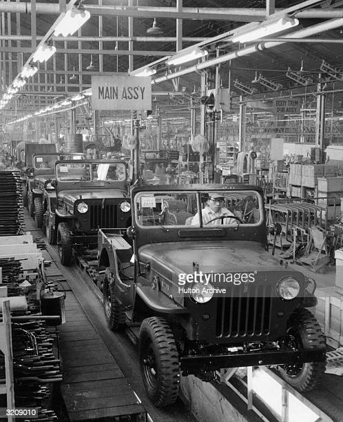 Interior view of the main assembly line where Willys Jeeps are manufactured at a Mitsubishi factory Japan