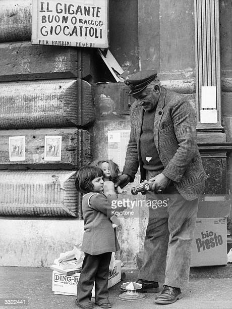 Italo Taddei a car parking attendant who was named the 'good giant' for his efforts in collecting toys for the poor children of Rome Here he is...