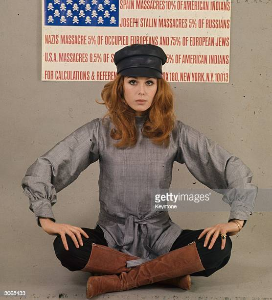 Joanna Lumley the 'Bond' girl and star of the TV series 'The Avengers' as Purdy beside an antiwar poster in the form of the American flag