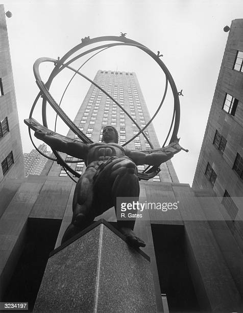 Low-angle view of the bronze statue of Atlas, which was designed by Lee Lawrie, in front of the International Building on Fifth Avenue at Rockefeller...