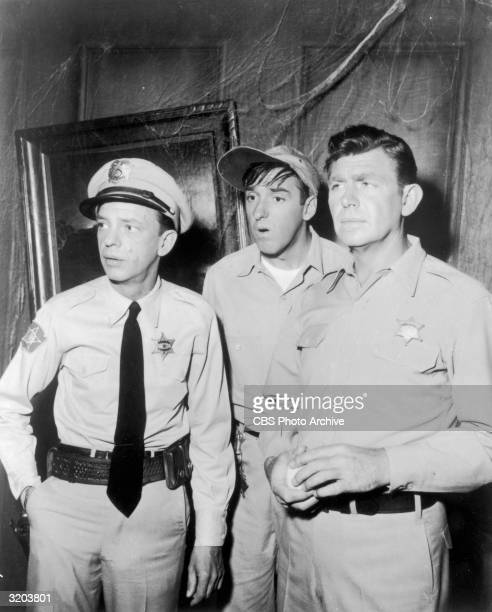 American actors Don Knotts Jim Nabors and Andy Griffith look perplexed in a haunted house, in a still from the television series, 'The Andy Griffith...