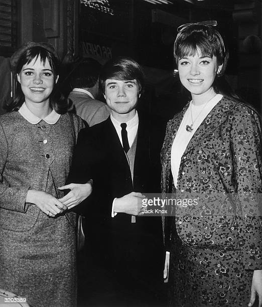 LR American actors Sally Field Jon Provost and Angela Cartwright smile while attending an event All were appearing in TV series Field played 'Gidget'...