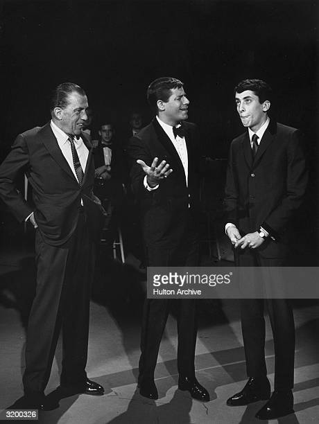 LR American television show host Ed Sullivan stands next to American actor and comedian Jerry Lewis and his son Gary Lewis during an episode of 'The...