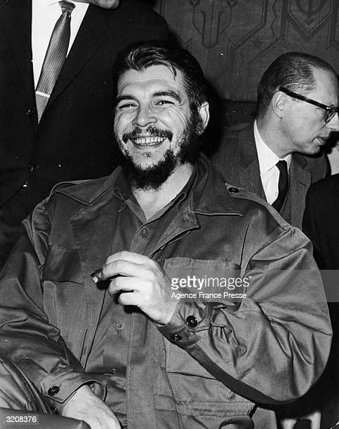 Portrait of Ernesto 'Che' Guevara Cuban Minister of Industry smiling and smoking a cigar at a Security Council meeting at the United Nations New York...