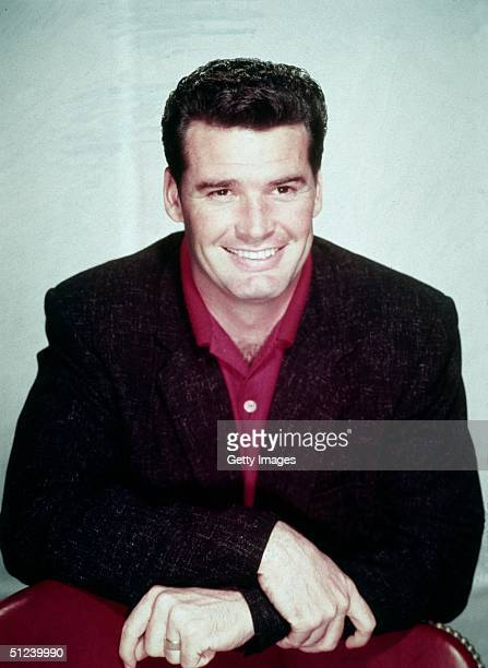 Circa 1965, Promotional portrait of American actor James Garner wearing a dark sport coat over a red shirt, 1960s.